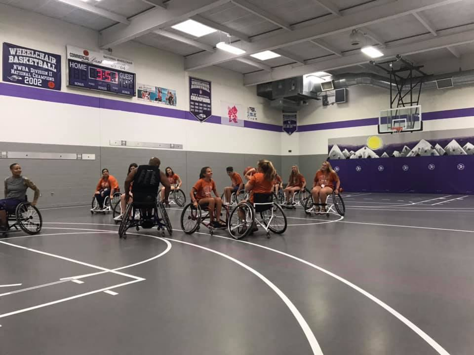 Wheelchair basketball in gym
